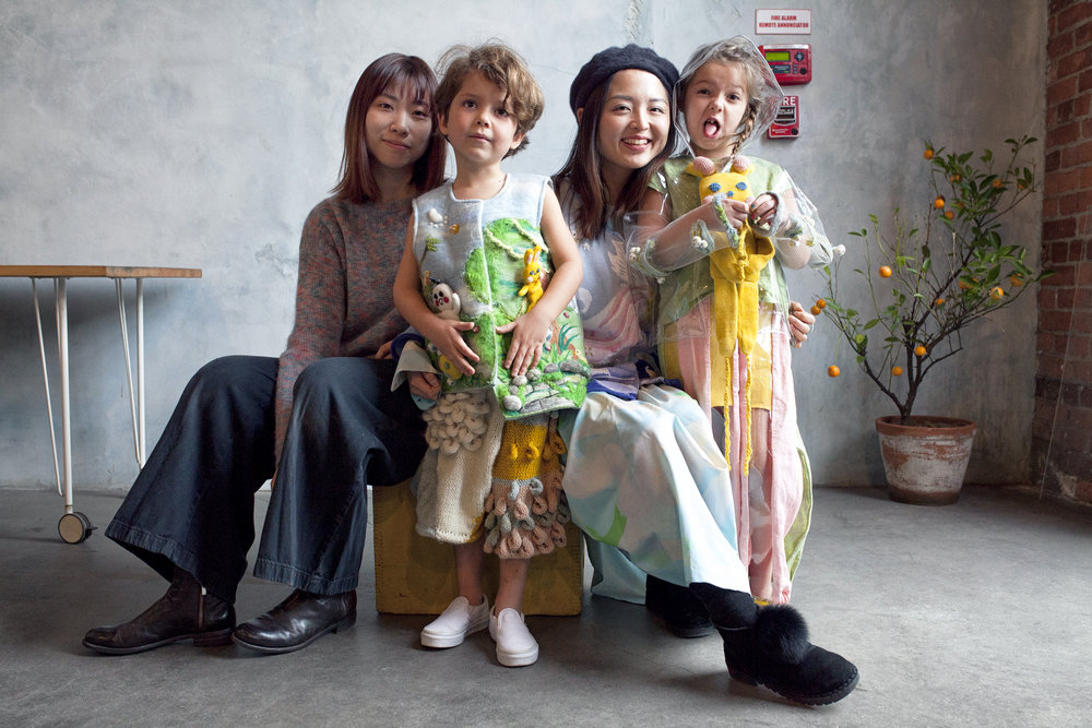 """Meet Teasy and Friszi :) - About Teasy Shiruo SunAs a children's wear designer, Teasy wants the wearer to play and learn through her designs. Her design approach is to create interactive toy garments through her knowledge of textiles and her unique illustration style. Children will learn from what they wear as they play, and use their imagination to create some special moments with their outfits.About Friszi Tianyang JinAs a knitter, dyer, painter, and designer, Friszi is always obsessed with the nature which is what she thinks most essential to life. She loves working with natural elements and take inspirations from the nature. During her visit to southwest Guizhou where many indigenous tribes have kept the practice of indigo dyeing for hundreds of years, she became more aware of how people can live with the cycles of the nature without any high-tech involvement. While keeping the minimal aesthetics and believing in """"less is more"""", she is also into the theme of fantasy as it brings more fun to life."""