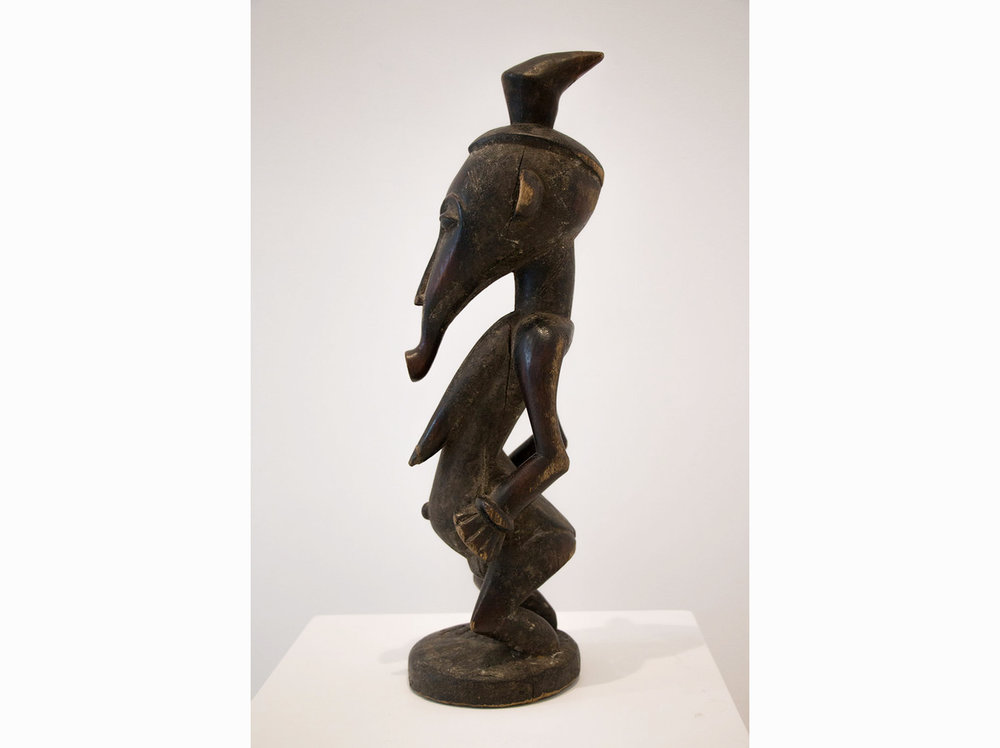 Côte d'Ivoire   Figure of woman Senufo | l ate XIX century | wood carving | 55 x 58 x 18 cm.