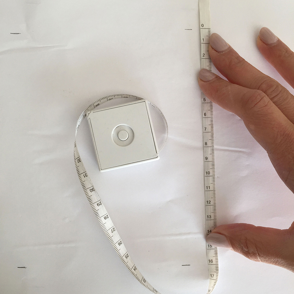 3. Measure the distance between the two marks on the paper for the length.