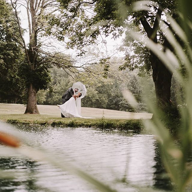 A deep dip by the #pond on the #PlantationPartyHouse grounds, captured by the talented @marshallartsstudios. (Beautiful newly weds Valerie & Justin). The banquet hall at the Plantation Party House is surrounded by 25 acres of landscaped grounds and also features a multi level deck, large gazebo, and rustic foresty areas on the perimeter of the property that provide fantastic #photoops for #weddingphotography year round.  #rochesterweddings #rochesterwedding #585wedding #585weddings #rochesternewyork #RochesterNY #receptiondecor #outdoorwedding #banquethall #rochesterbride #rochesterbrides #rocbrides #brideandgroom #umbrella #whenidipyoudipwedip #weddingphotos #weddingphotographer #rochesternewyork #outdoorwedding #weddinggoals #weddingreception