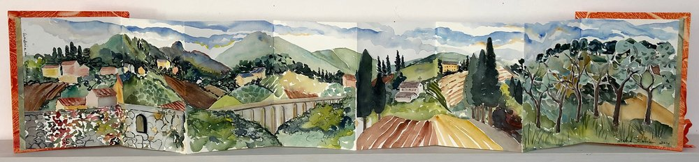 "October in Umbria.  Three dimensional accordion book: watercolor, ink, cut paper on Arches Text wove paper. 6-1/2""x7"" closed. 6-1/2""x34"" open."