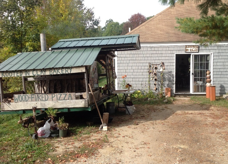 Entrance to Rooted in Clay Studio, with wood-fired oven trailer on left.