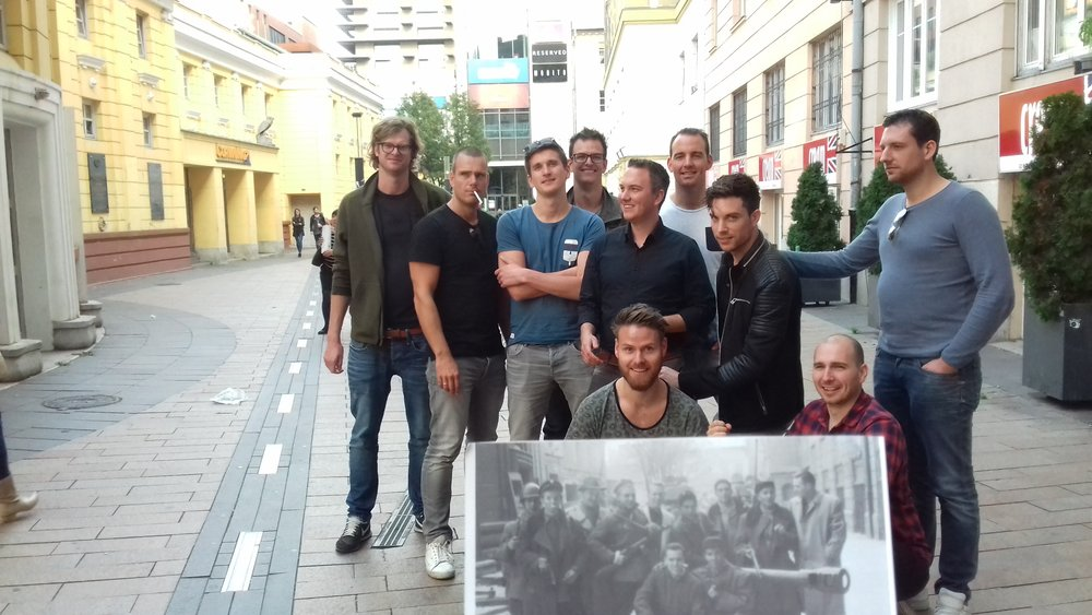A bunch of amazing Dutch guys re-enacting a group photo of Hungarian freedom fighters of the 1956 revolution during a custom-tailored Cold War tour