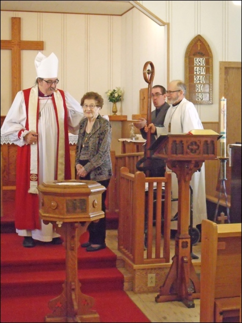 Ann Brand confirmed by Right Rev. Harper with Rev Carr and Tim Latimer looking on.