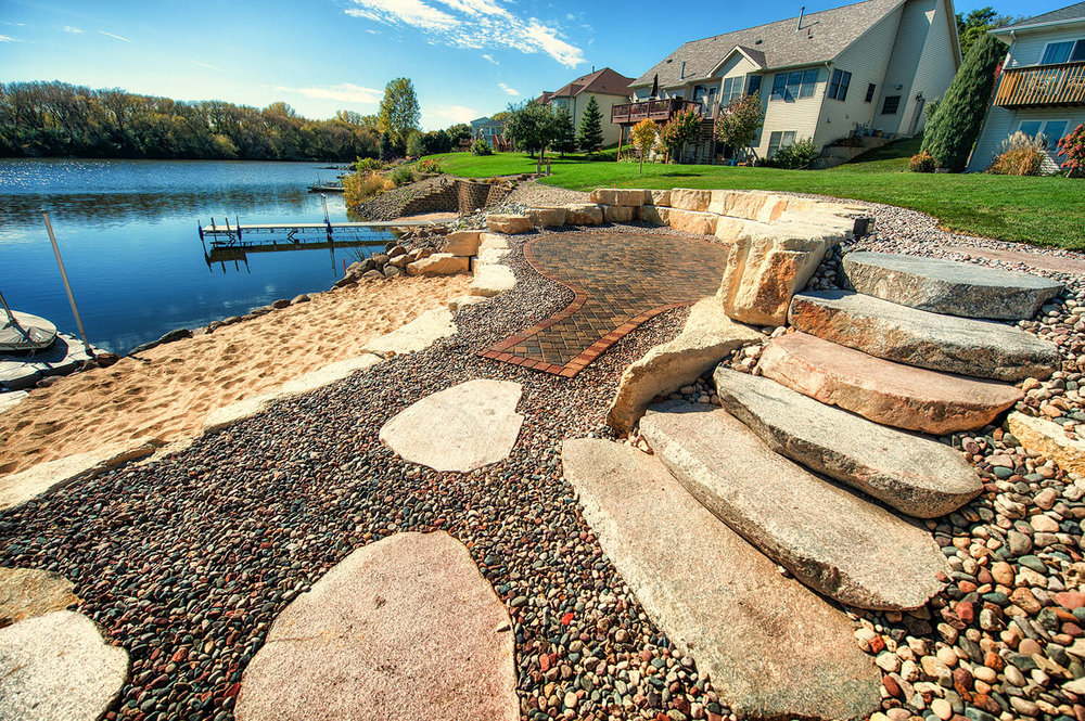 Natural Stone - Natural stone and boulders are often used for the natural richness and beautiful textures, and few landscaping features are more effective, strong and durable than natural stone.