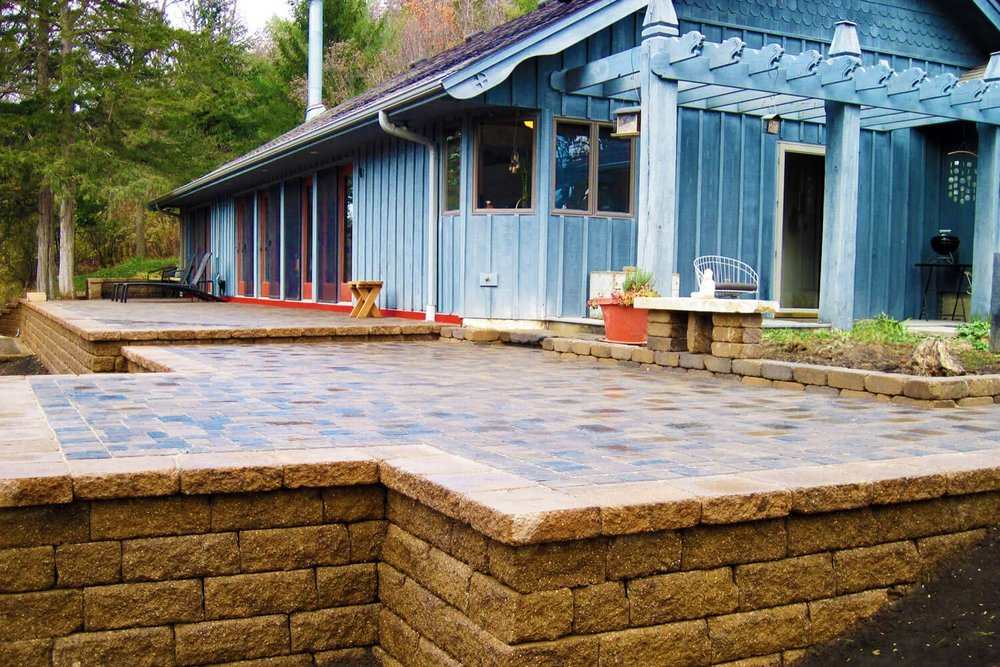 WALKWAYS & PATIOS - We provide unique patio design & construction services utilizing top quality Willow Creek and Bogert paver stones.