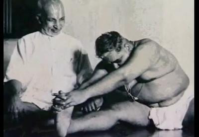 T. Krishnamacharya teaching the yoga posture Janu Sirsasana