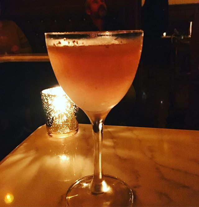 """I have to admit, when I hear """"speakeasy,"""" I think """"been there, done that, got the t-shirt,"""" but when I entered @1122.cocktail.lounge from their little curtained vestibule, I snapped right out of my cynicism. It brought me back to the first time I went to @peguclub_nyc when I was a wee young thing in 2007 and how wowed I was by the beautiful bar, gorgeously dressed staff, and shelves and shelves of obscure bottles waiting to be discovered. So if you're in Paso Robles, take a break from wine and have a fancy ass cocktail 🍹 #travelpaso #nickandnora #fancyassdrinks"""