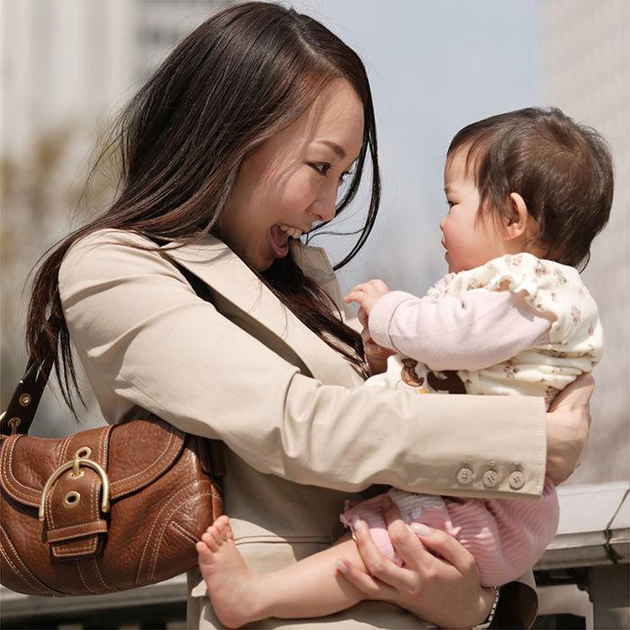 beautiful-east-asian-mom-holding-infant_700x700.jpg