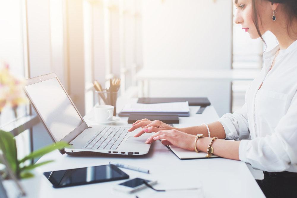 lady-at-desk-bright-phone-laptop.jpg