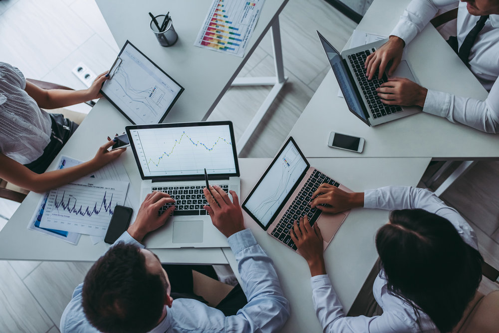 team-on-laptops-and-graphs-digital-marketing.jpg