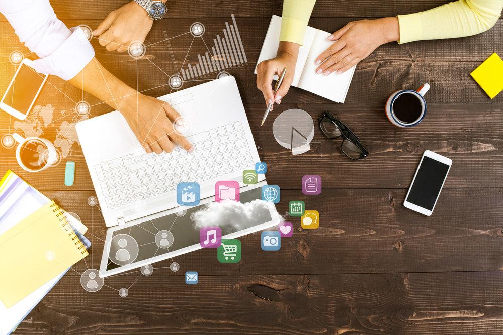 digital-marketing-desk-meeting-icons-phones-laptop.jpg