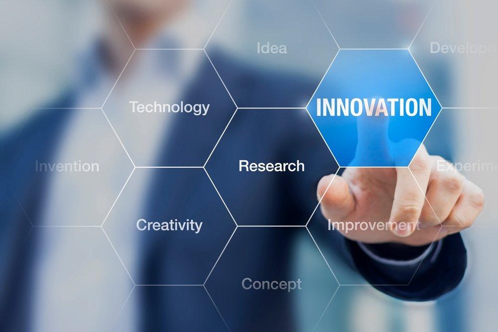 man poiting to Innovation iStock-502287938.jpg