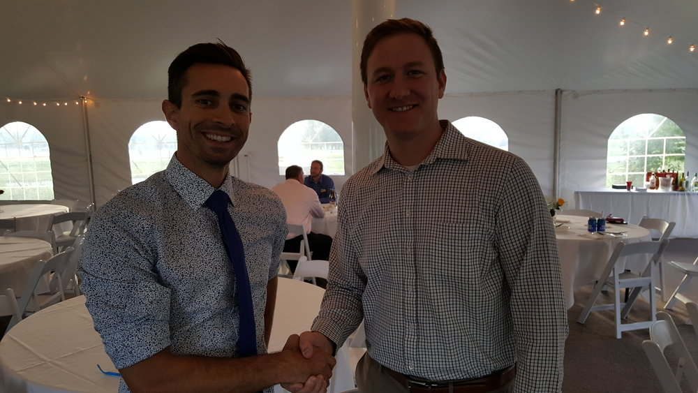 President Sean Bull and Member at Large Jeremy Gebhardt at The Rail After Hours event.
