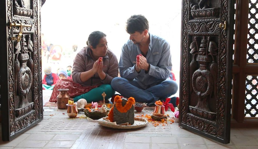 Director Thomas Morgan praying with Pushpa Basnet, subject of  Waiting For Mamu.