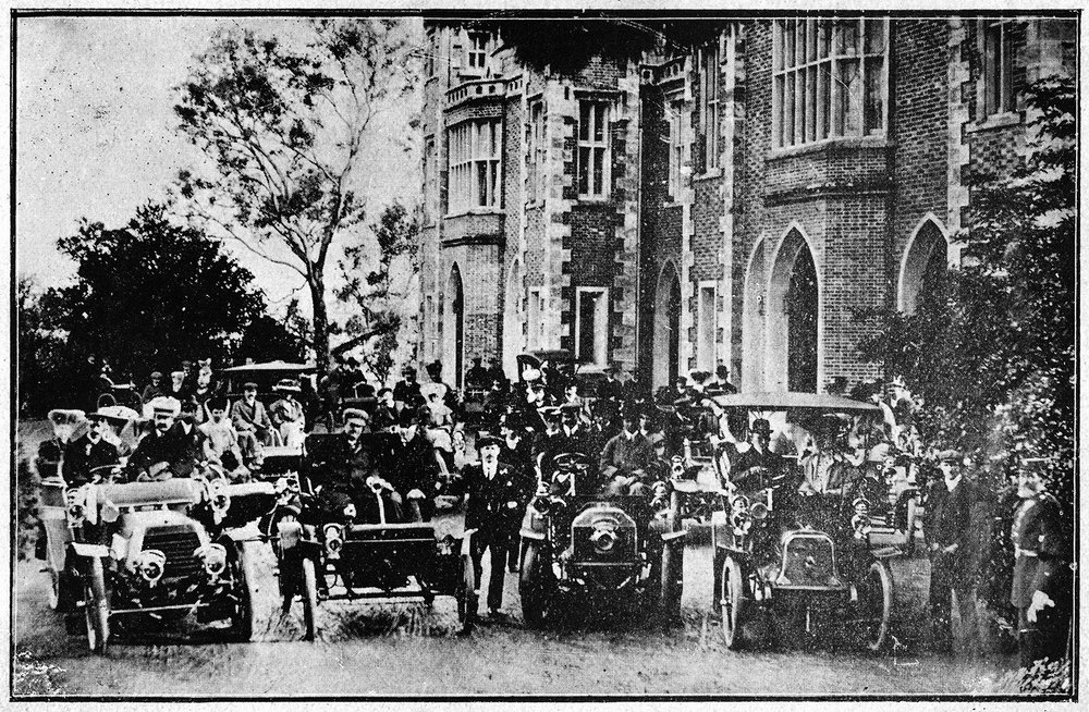 Gathered at Government House for the first Club run, 1 July 1905.    L-R, front: Richard Strelitz in his Daimler; Alfred Morgans in his Oldsmobile with Governor, Admiral Sir Frederick Bedford GCB; Claude Deane; and Dr Ormsby Burkitt in his Argyll. Courtesy RAC Archives and identified by Kevin Winser in The Story of Australian Motoring, p175. The women have adopted the growing international style of draping fine tulle over their hats and faces and tying it under the chin. This served to avoid both bugs in their faces and their hats from flying off.