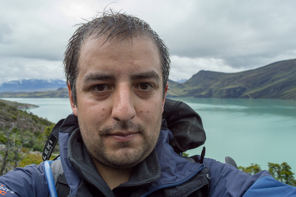 At Lake Nordensköld - In 2013 I went to Torres del Paine National Park, in my home country of Chile. Here I am overlooking Lake Nordenskjöld and its magnificent blue waters.