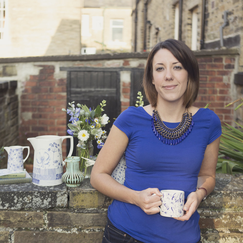 What Kate Loves - Kate Thorburn is a Yorkshire based designer having a background in both ceramic and card design. She successfully completed an MA in ceramic design at Staffordshire University in 2007 and then launched her own range of ceramics 'What Kate Loves' in 2014.In Kate's work there is a strong emphasis on colour, pattern and decorative details. She is a collector of beautiful objects, lovely jugs and plates and images such as old postcards as well as objects she has found like pinecones and shells, which she has found on her travels.Launching her range under the name 'What Kate Loves', she hoped to create a range that draws on the past traditions and combines this with contemporary trends to develop her own unique style. It is hoped that the beauty and elegance of this collection will have the 'timeless elegance' to become the treasured objects of the future.Kate loves to draw and finds inspiration from everything around her. Walking through meadows in the countryside, picking up some vintage fabrics or simply making doodles. Kate wanted to create her own beautiful range of blue and white that draws on her loves.The elegant artwork is all hand drawn by Kate; she then combines her drawings digitally to create her own unique style. Individual designs are created for each and every product for a very special collection!