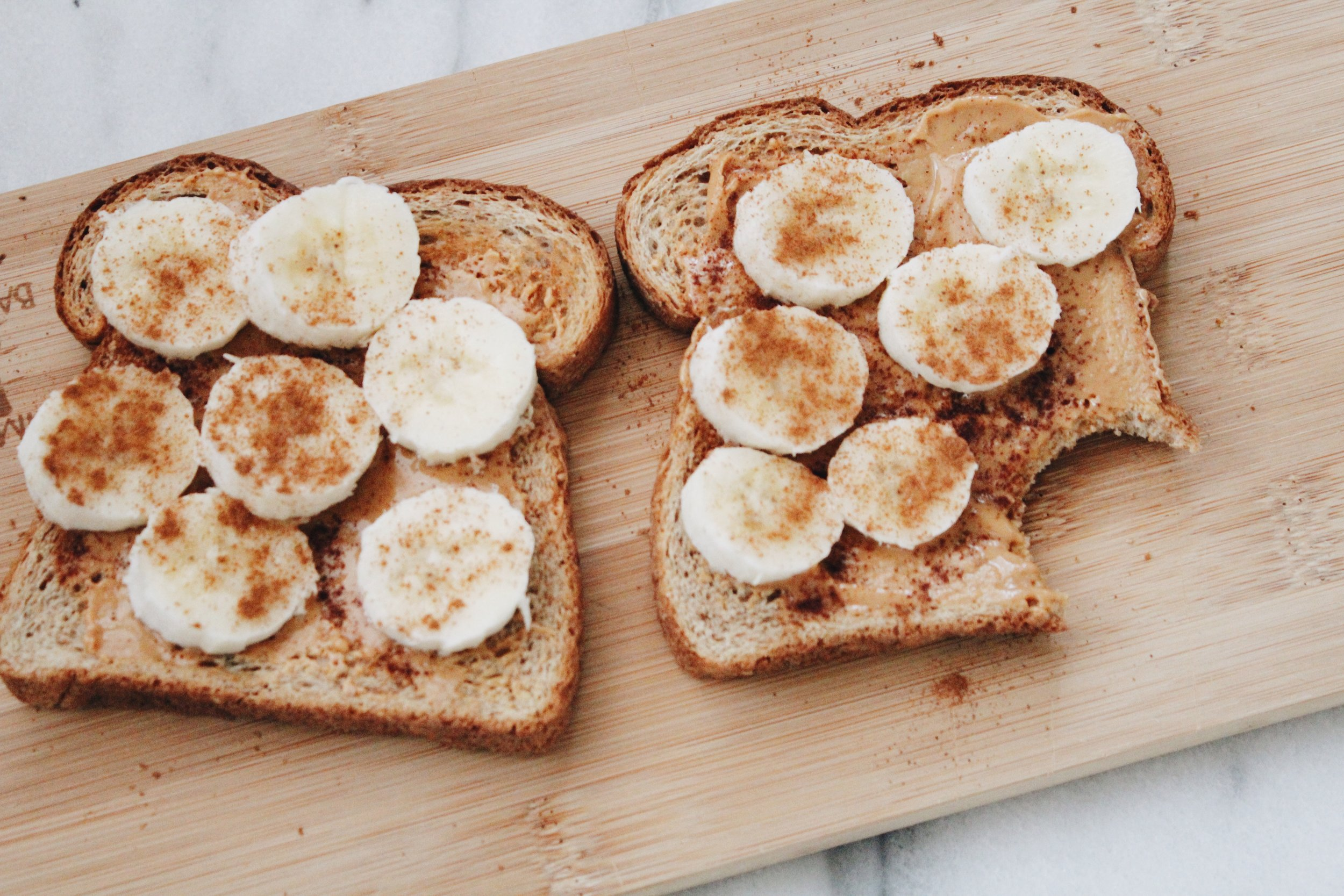 Peanut butter toast with banana slices and cinnamon