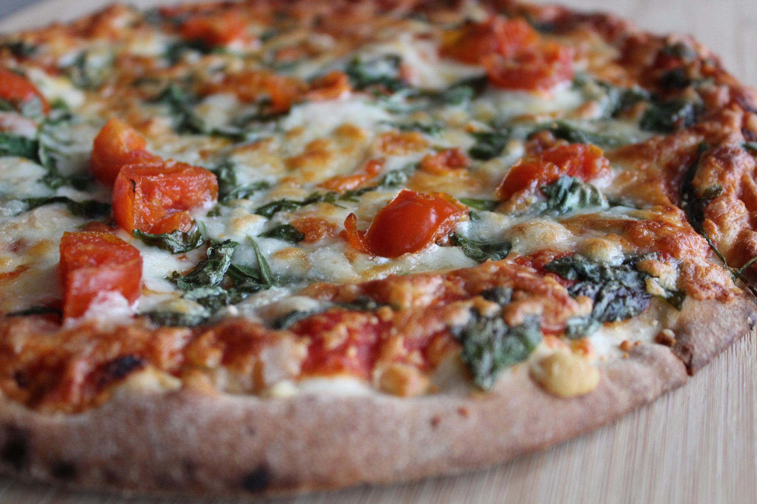 Arugula tomato pizza from Trader Joe's