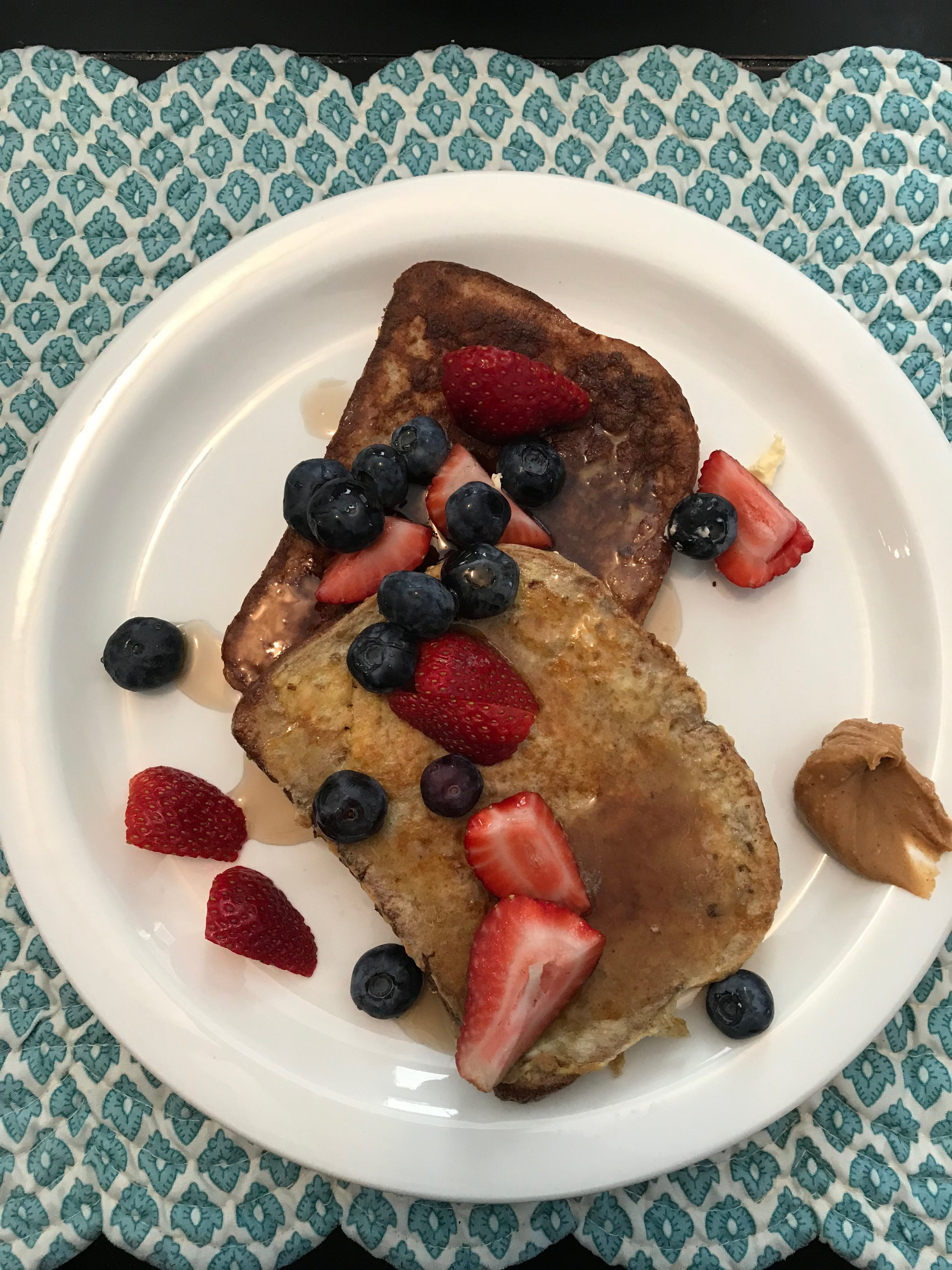 French toast with peanut butter, syrup and berries