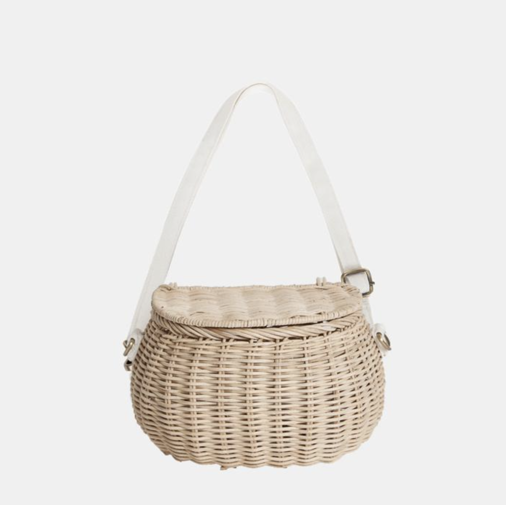 Bag - Ok this bag is everything! It is not only absolutely adorable; but, totally functional too! Neva loves to carry a purse and this fits more than most kids' purses and attaches onto the front of her scooter. I love this natural color but it also comes in beautiful color options.