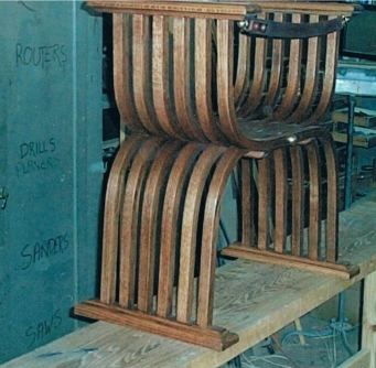 Rear view of bishop's chair, with leather strap back.