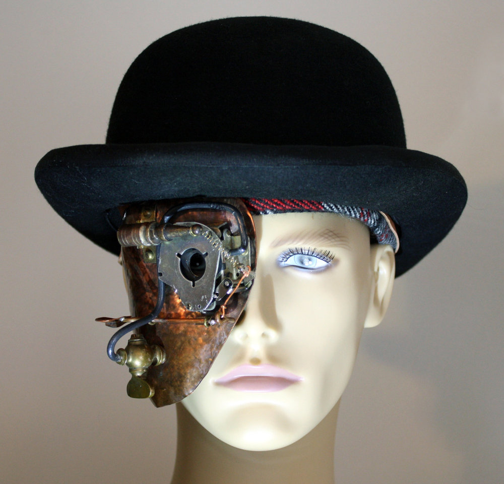2012. Copper, camera shutter, leather strap. Made for the Albany Center Gallery's Masked Gala.