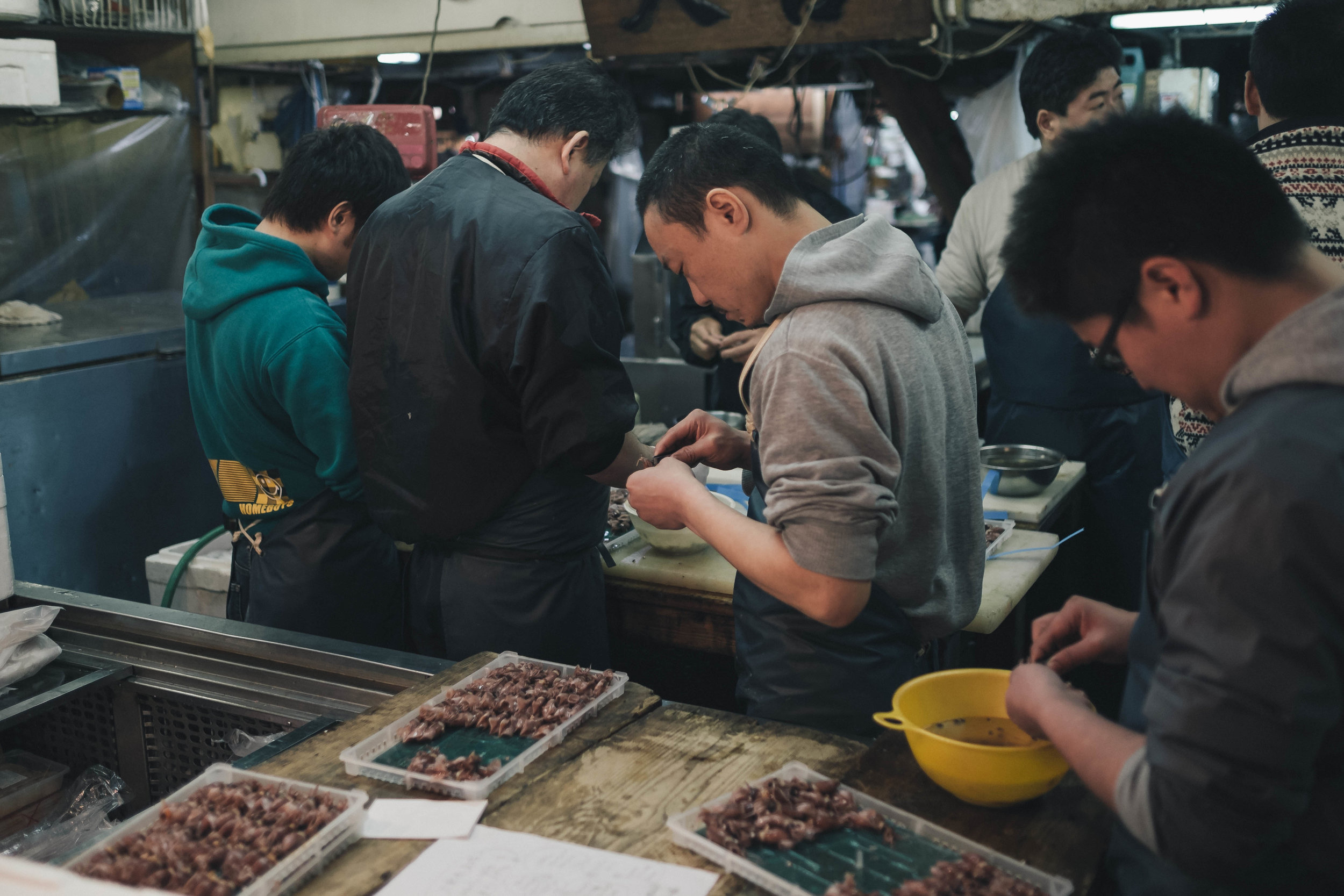 Cleaning up some sea creature at Tsukiji Fish Market, Tokyo.