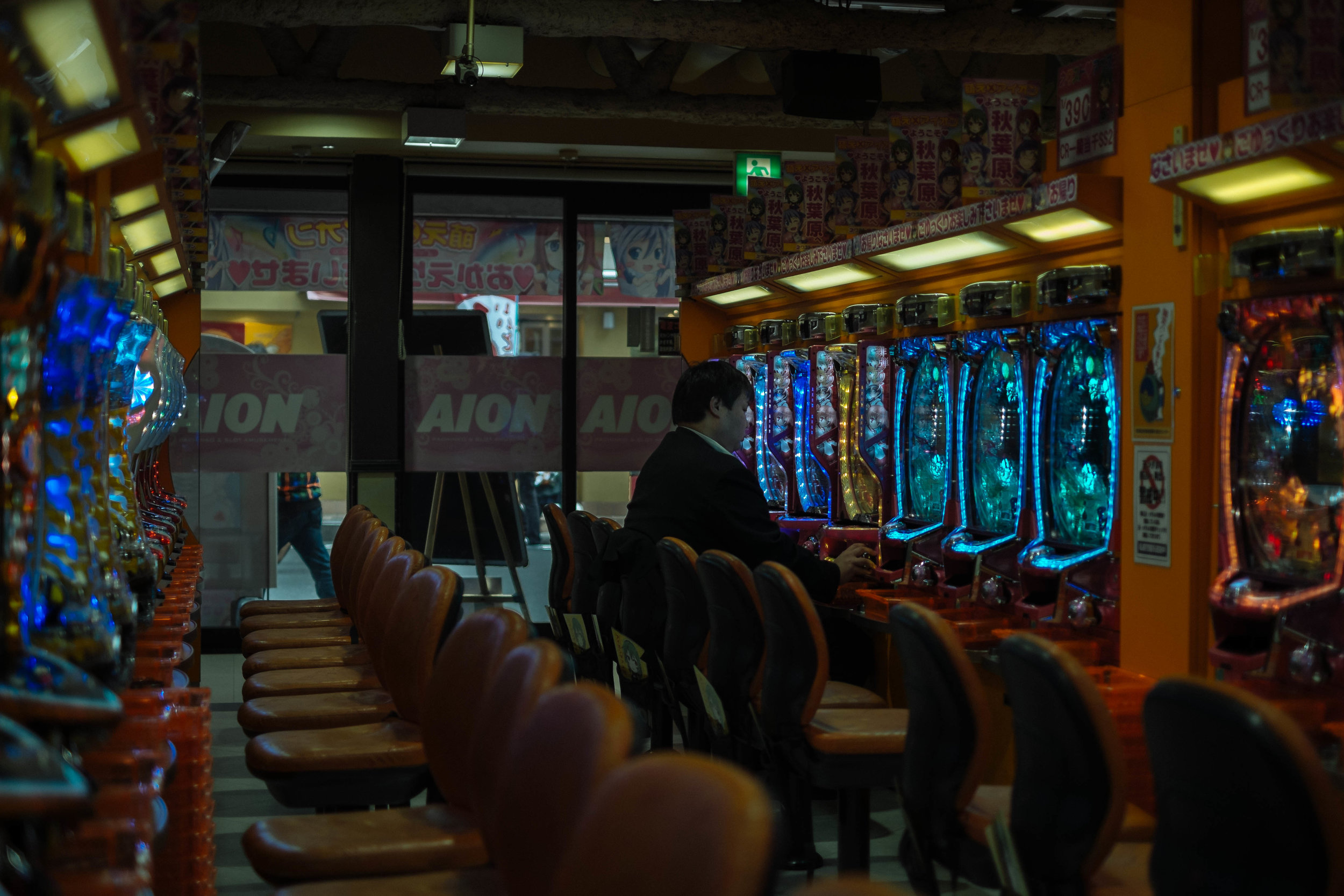 Man playing Patchinko, alone in Tokyo.
