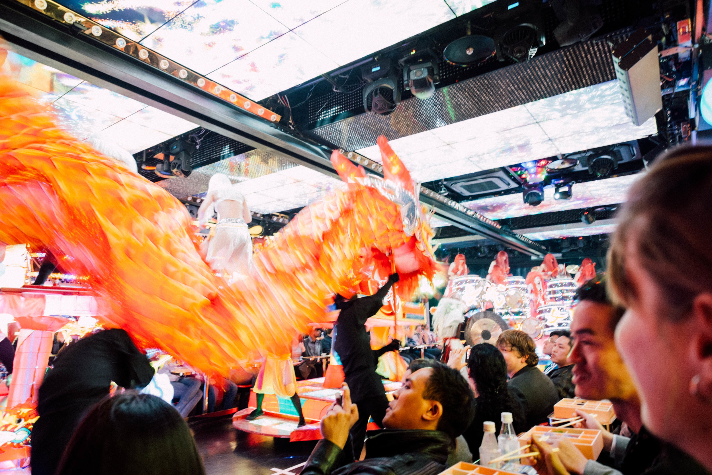 A dragon flies among the crowd, Robot Restaurant, Tokyo.