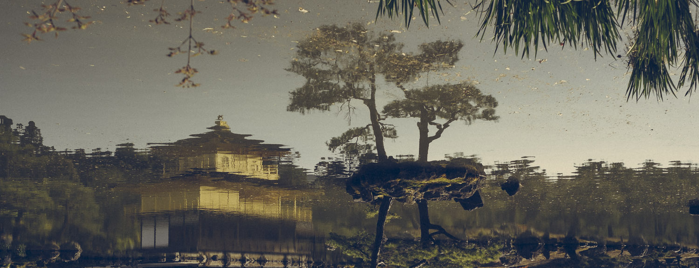 Kinkaku-ji, the Golden Temple, reflected in it's surrounding pond.