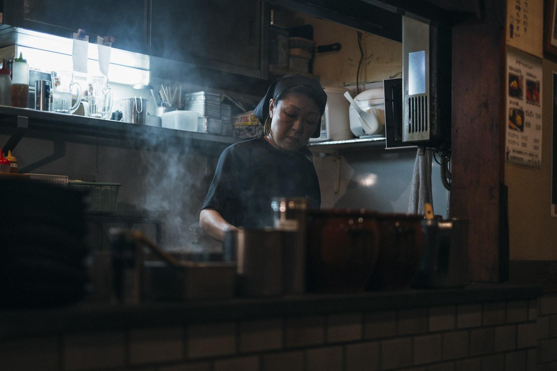 Woman cooking Okonomiyaki in Kyoto.