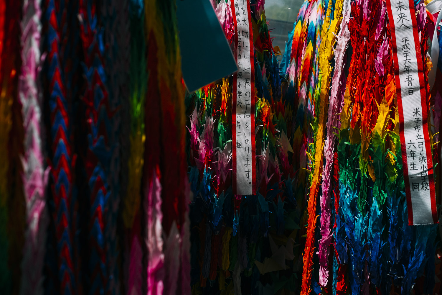 Hundreds of paper cranes are hung here by children with messages for peace.