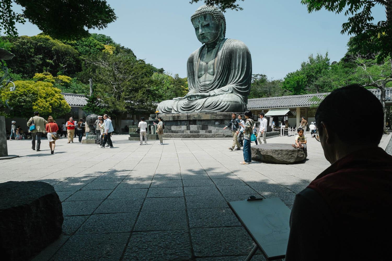 Man sketching the Great Buddha in Kamakura.