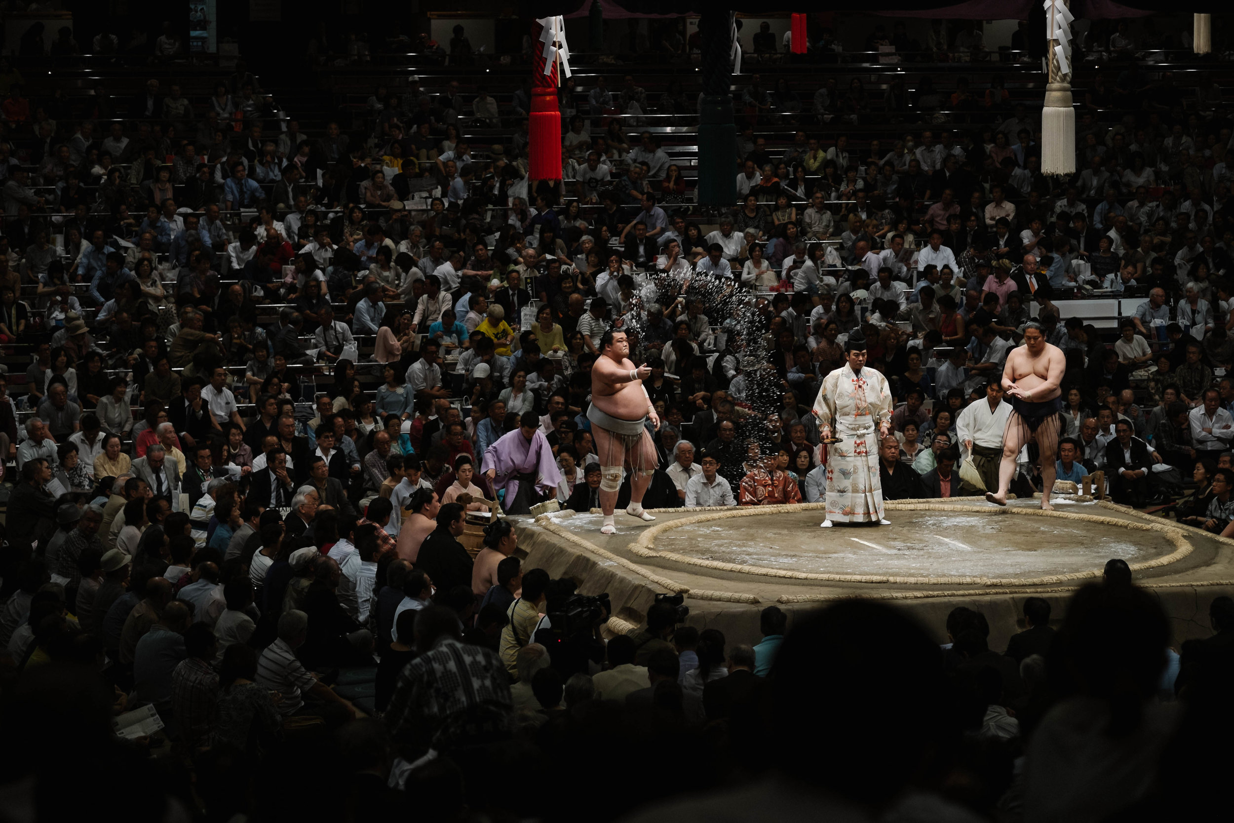 Purifying the ring by throwing salt, Sumo tournament, Tokyo.
