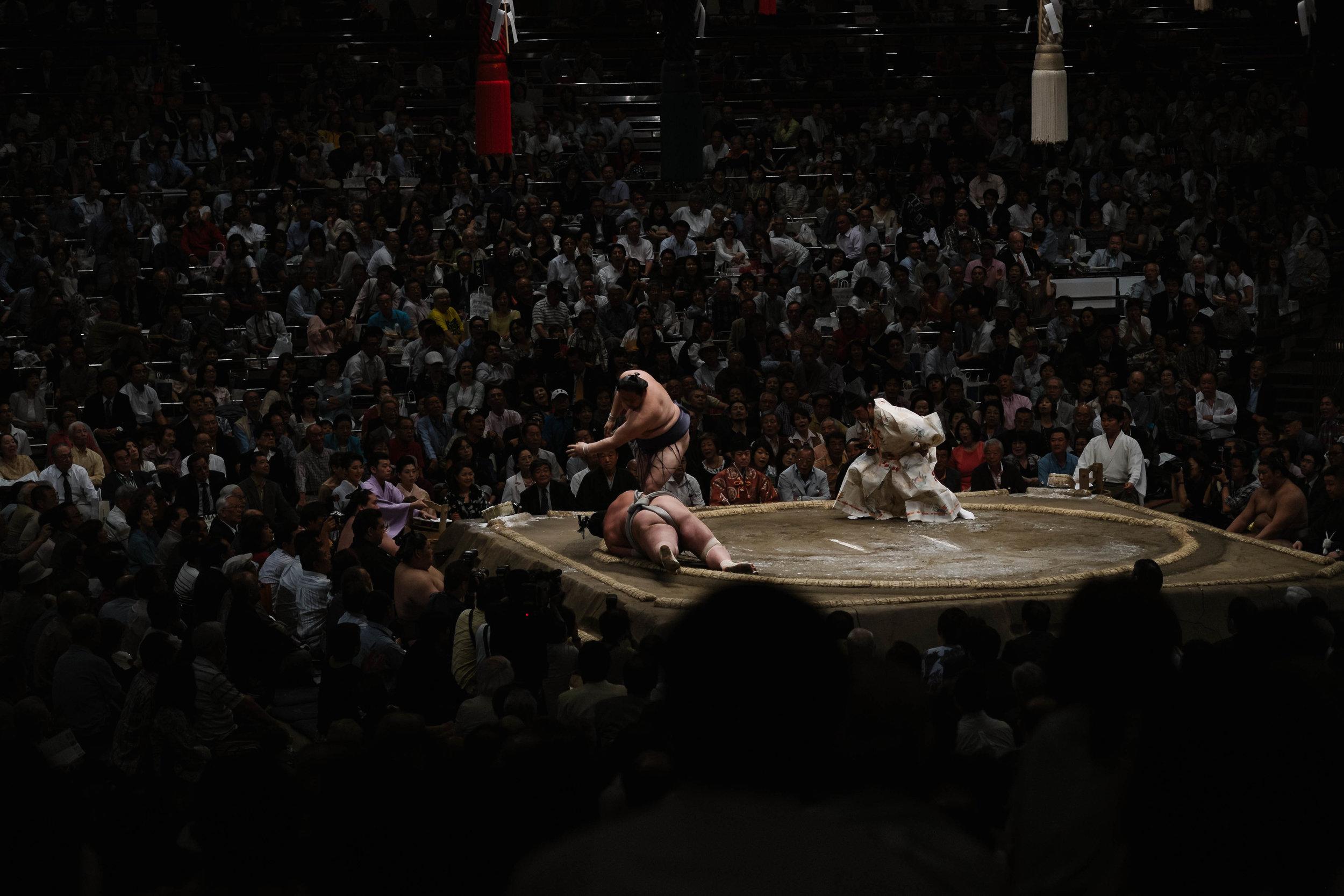 Down he goes, Sumo tournament, Tokyo.