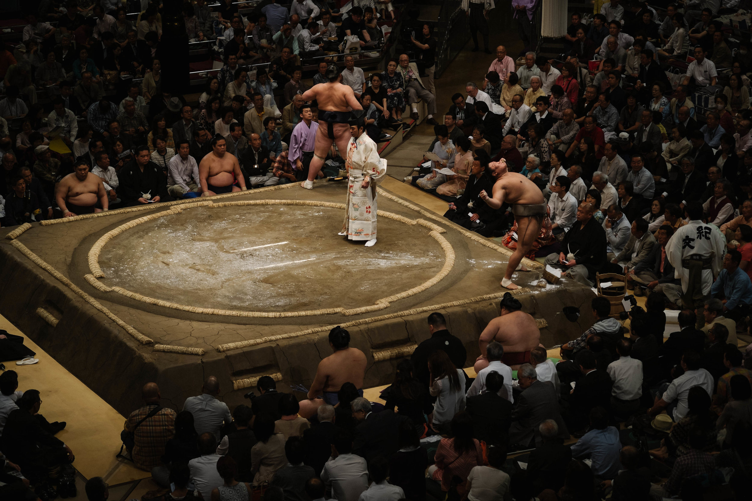 Rinsing mouth as per Shinto ritual and intimidation, Sumo tournament, Tokyo.
