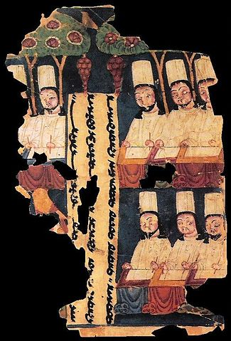 Manichean priests (Iranian Gnostic Sect) writing at their desks, with panel inscription in Sogdian. Manuscript from Khocho, Tarim Basin.