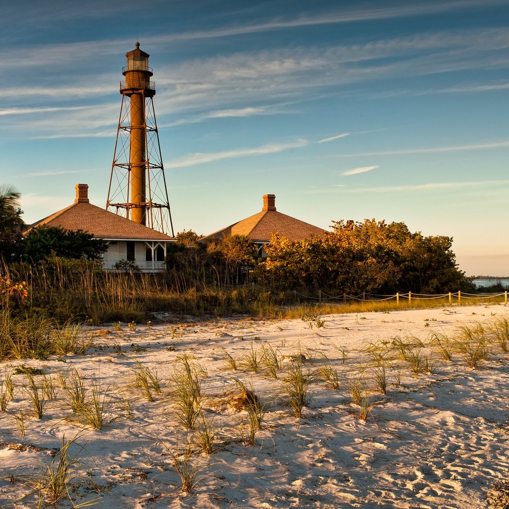Lighthouse and Pristine Florida Beach at Sunset