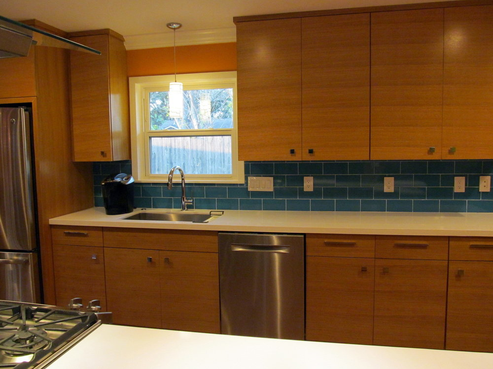 Rift cut white oak cabinets are great with turquoise glass..JPG