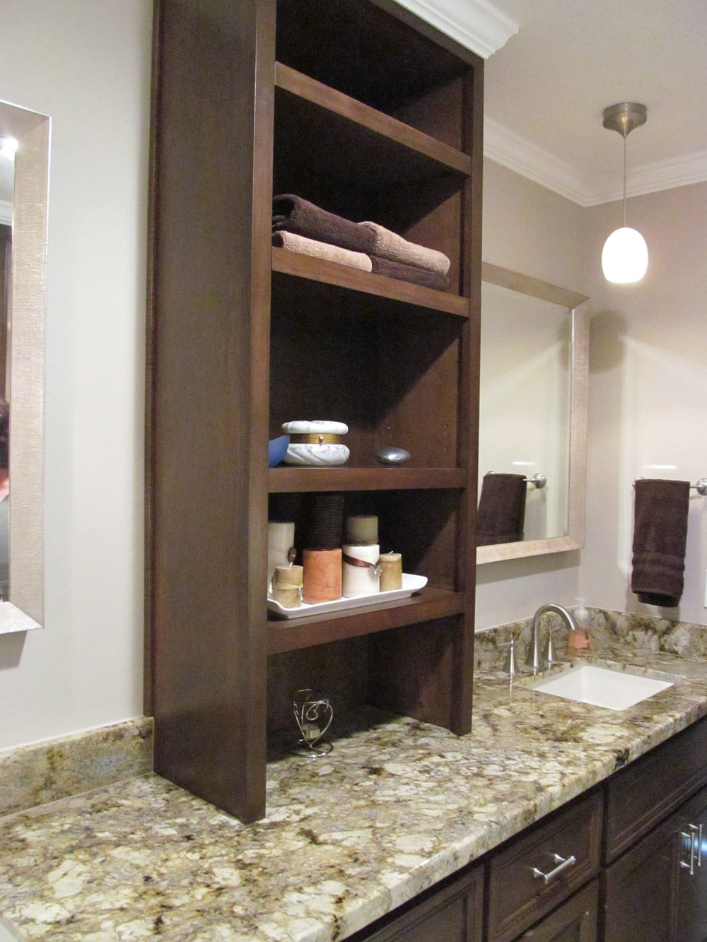 Tower cabinet adds a great deal of charm and space.JPG