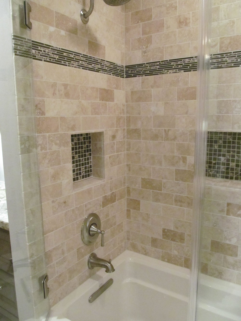 Tub shower combo accent tile was the inspiration for the look in the bathroom.JPG