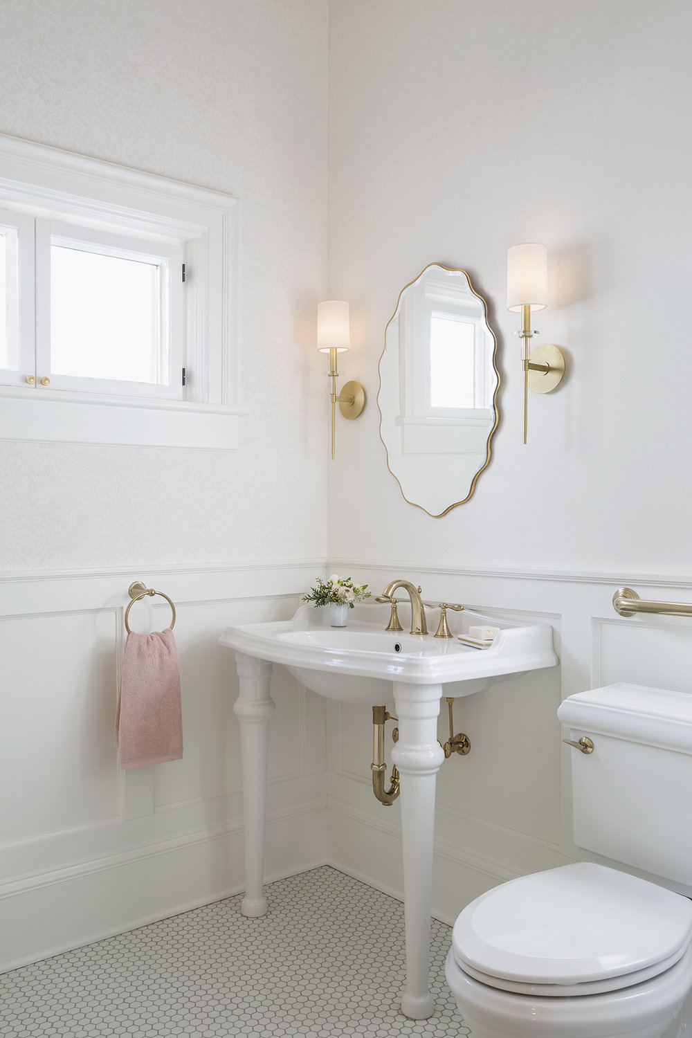 A powder room in a historic Saint Paul home shines with traditional flourishes and a touch of glamor.