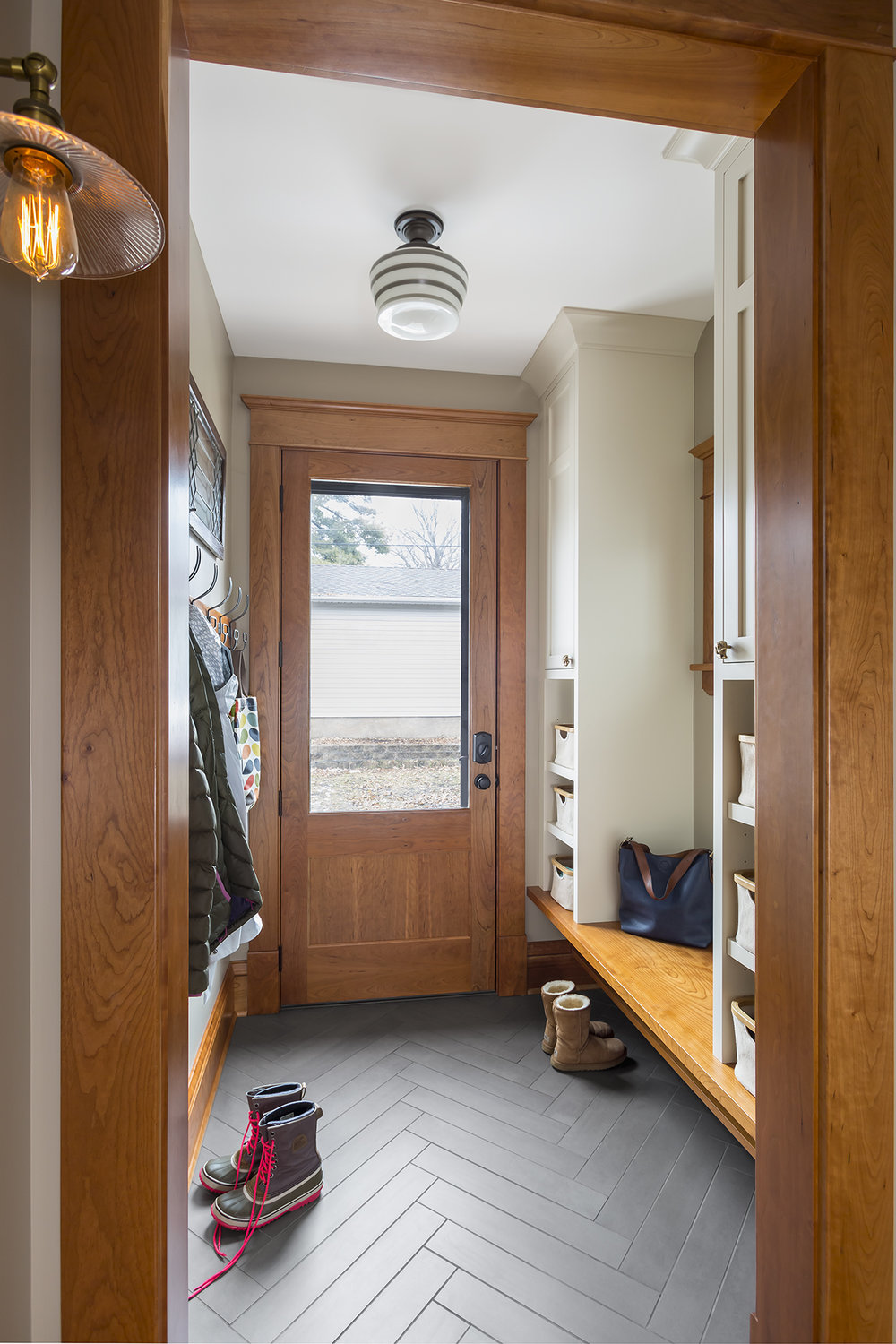 A welcoming mudroom was created by enclosing a former back stoop.