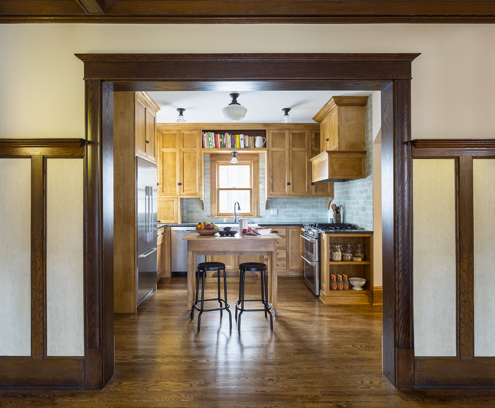 Enlarging the original cased opening between the kitchen and the dining room allowed this space to work better for the clients while still maintaining the historic charm of the home.