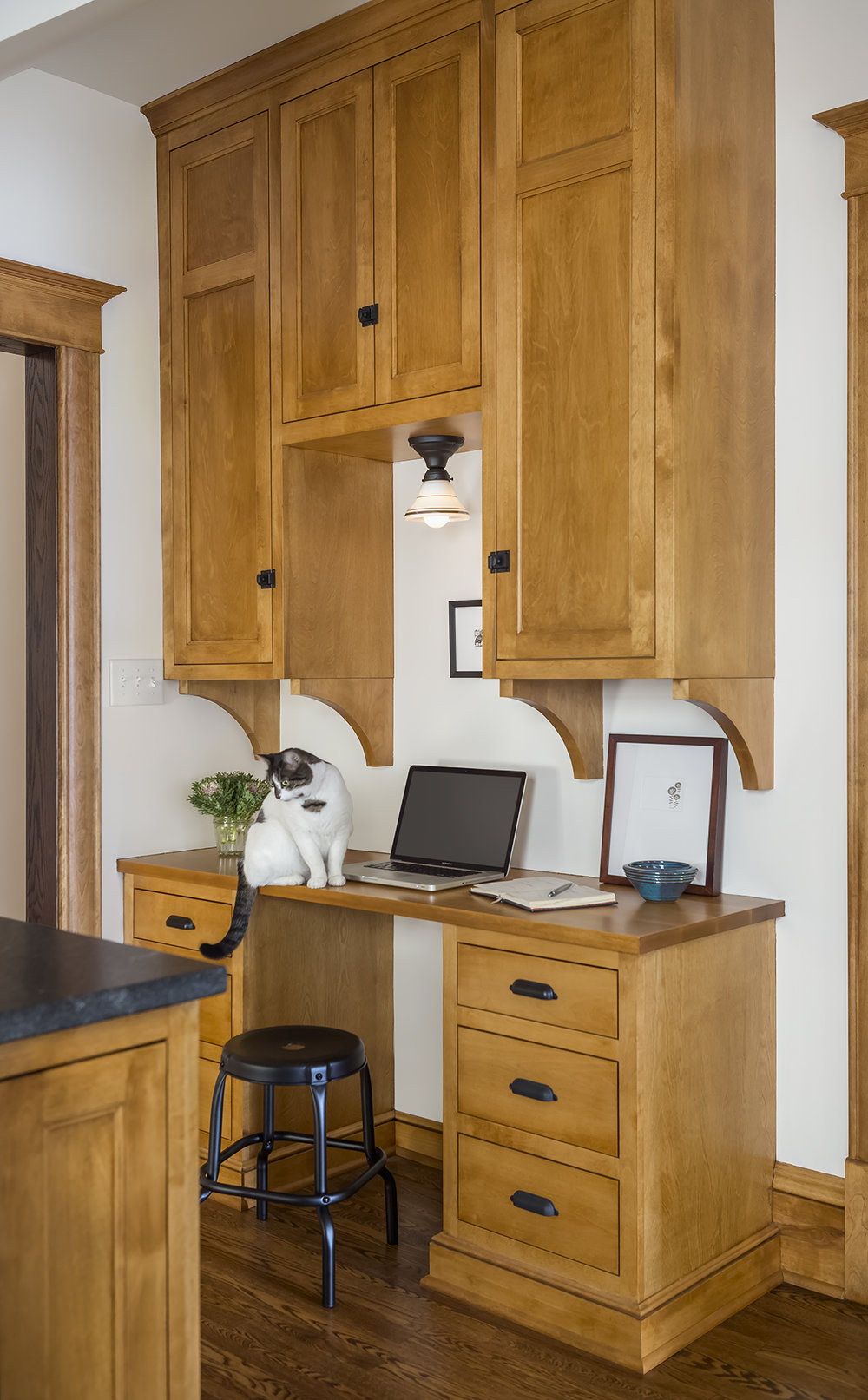 A new desk area and command center was added to the space to minimize clutter and chaos in other areas of the home. Additionally, a new door into the front room was created to ensure ease of flow throughout the first floor.