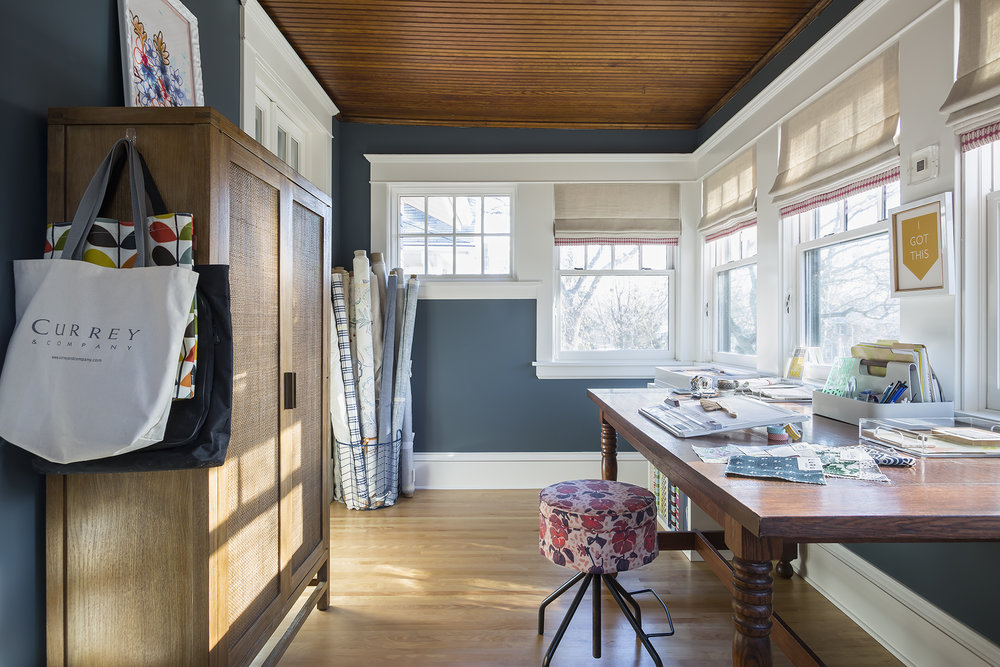 The room was completely rebuilt with all new windows, a new birch floor, and casing to match the rest of the house. The room was also insulated and a radiator and air conditioning were added.