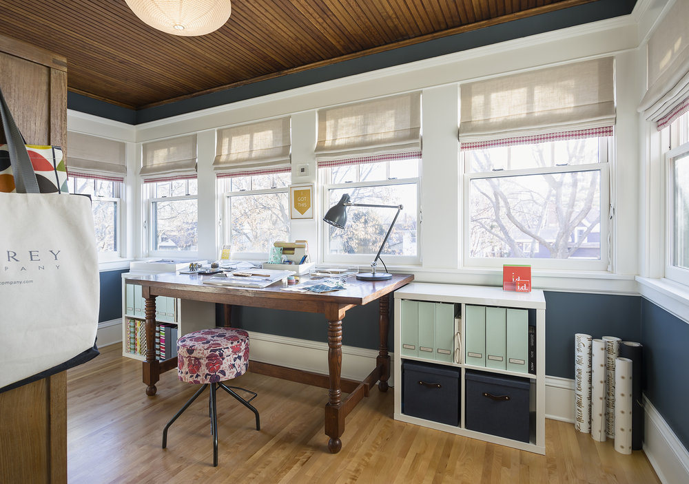An old sleeping porch was transformed into a contemporary home office.
