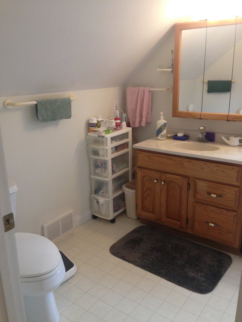 Builder-grade materials and inefficient use of the space didn't allow the bathroom to live up to its potential.